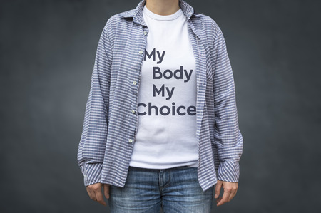 My body my choice message on white t-shirt. Selective focus.