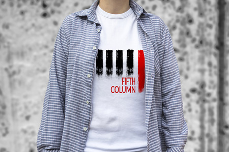 guerilla: Fifth Column print on t-shirt. The group is attempting to disrupt peaceful government from within, using sabotage, disinformation or espionage.. Selective focus.