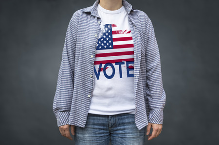 Vote Presidential Elections USA flag. Print on T-shirt, political message. Selective focus. Stock Photo