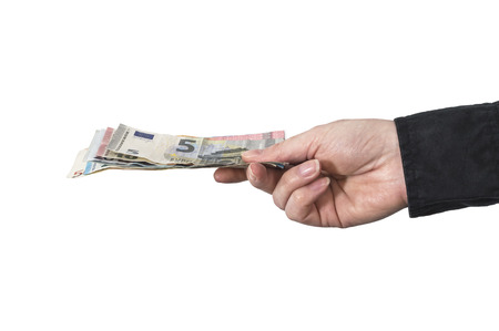 Hand is holding Euro money over white background. Business concept.