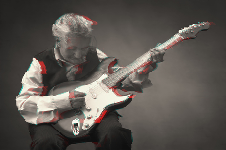 Elderly woman playing guitar. Glitched style photo. Stock Photo