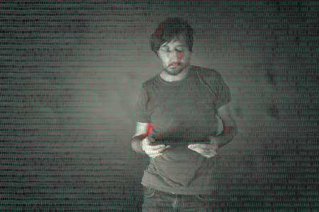 The cyber criminal, person using a tablet in deep web cyberspace. Glitched style photo. Stock Photo