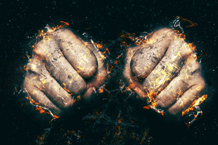 Two fists in flame, fire illustration. Fight concept. Stock Photo