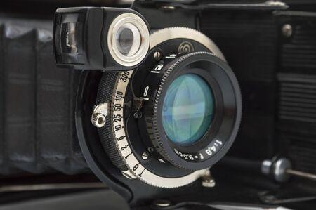A retro camera lens close-up. Selective focus