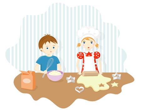 男の子と女の子のクッキーを焼く