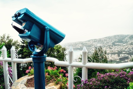 Large coin operated binocular looking at the town. Harissa. Lebanon