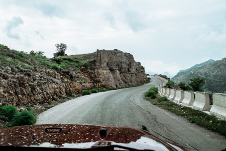 Landscape in spring in Lebanon : straight road heading to cliff and summits in Mount Lebanon,