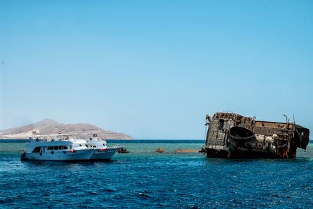 A badly corroded shipwreck of a beach at a beach at Sharm El Sheik, Egypt in summer