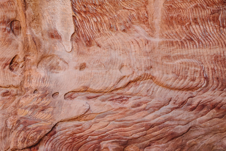 Colorful, red sandstone formation texture. Abstract geological pattern. Petra, Jordan, Middle east 版權商用圖片