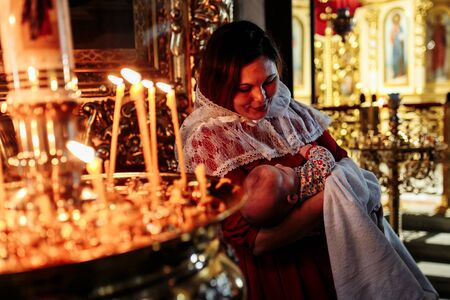 Dec 2018, Mother and child in church looking at candles