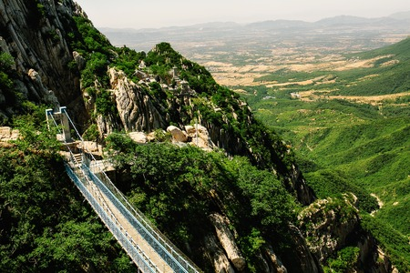 Trail and cliffs in Songshan Mountain, Dengfeng, China. Songshan is the tallest of the 5 sacred mountains of China dedicated to Taoism and stand above the famous Shaolin temple in Henan Province