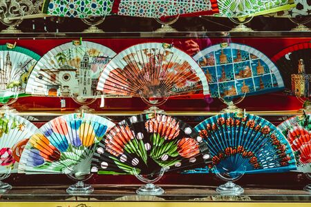 A variety of different Spanish hand fans on display for sale, Sevilla Seville , Andalucia, Spain. February 2019