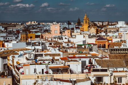 Seville, Spain, February 2019: beautiful view of street in city center with historic buildings and old architecture, aerial view, dramatic sky. Seville, Andalusia, Spain