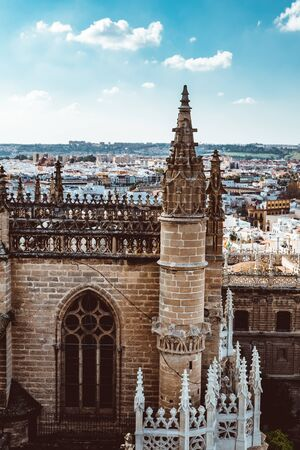 Aerial view of Seville city and Cathedral of Saint Mary of the See in Seville as see from seen from the Giralda tower. Seville, Andalusia, Spain, Europe