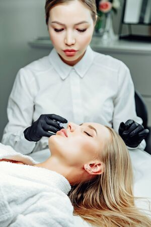 Non-surgical cosmetology. Filler injections. Correction of the shape of the upper lip.