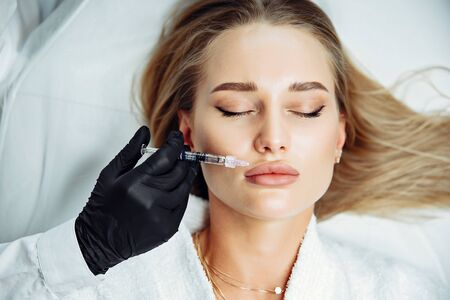 Injections of the lips. Correction form the upper lip. Injection of beauty. Spa. Facial Rejuvenation. Lip augmentation.