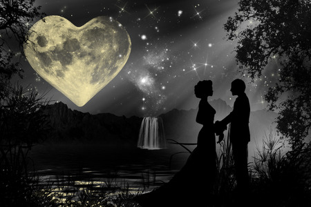 Valentine romantic atmosphere with heart shaped moon and a silhouette of a couple holding hands