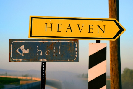 Two roads, two choices in life. Signpost to heaven or hell photo