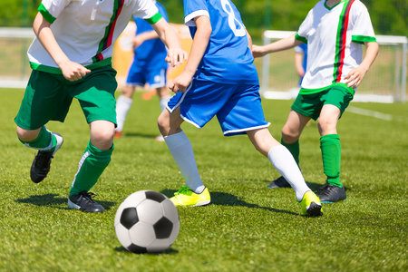 uniform green shoe: Football match for children. Training and competition football soccer tournament