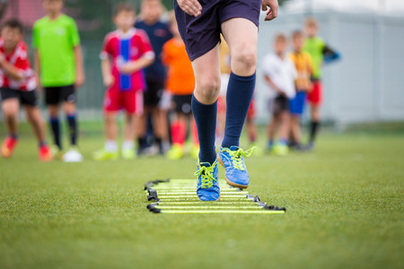 drills: Ladder Drills Exercises for Football Soccer team. Young player exercises on ladder drills