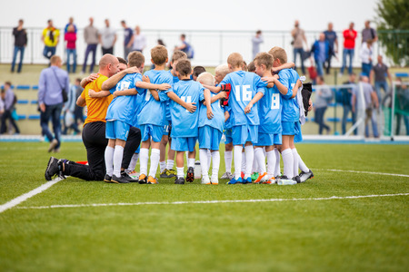 Football match for children. shout team, football soccer game. team work Stock Photo