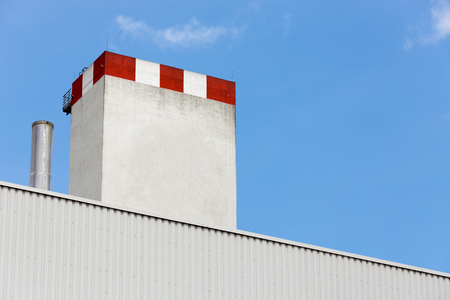 soot: Ecological factory chimney, clear air, lack of soot, blue sky Stock Photo