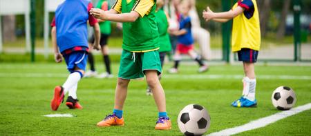 sport equipment: kids playing football soccer match