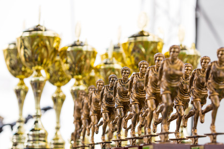 marathon running award: golden cups and trophies