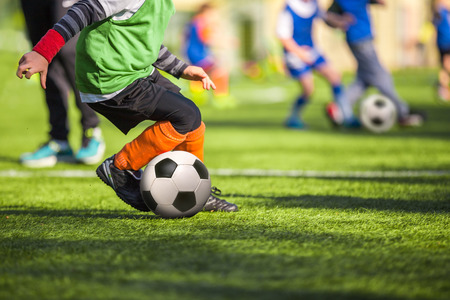 soccer ball on grass: Football training for children