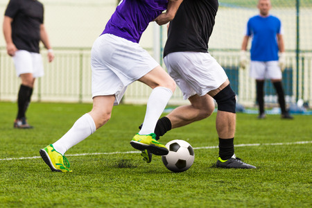 football soccer game. competition between two running players