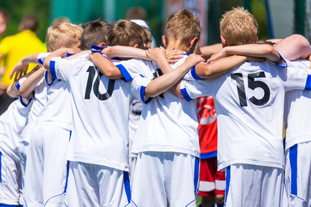 Football; soccer; handball; volleyball; match for children. shout team, football soccer game. team work 写真素材