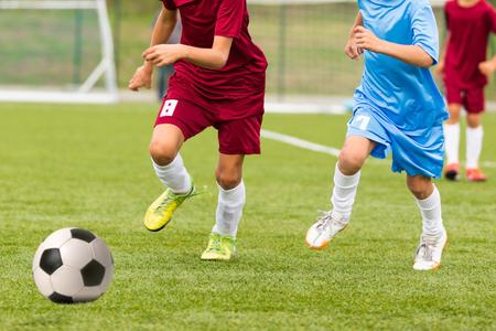 kids soccer: Football match for children. Training and football soccer game tournament