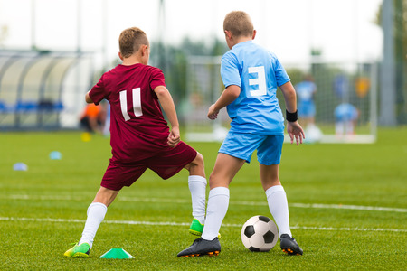 boy feet: Football match for children. Training and football soccer tournament