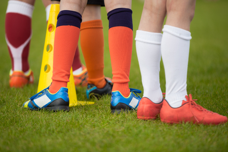 match: Sport background. Soccer team; football team; soccer socks and shoes Stock Photo
