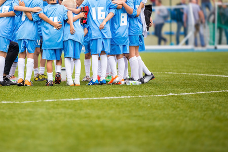 soccer pitch: Coach giving childrens soccer team instructions. Youth soccer team before final game. Football match for children. shout team, football soccer game Stock Photo