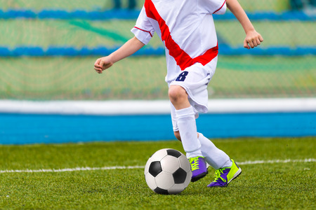boy ball: Soccer Football Player Playing Soccer Football Match