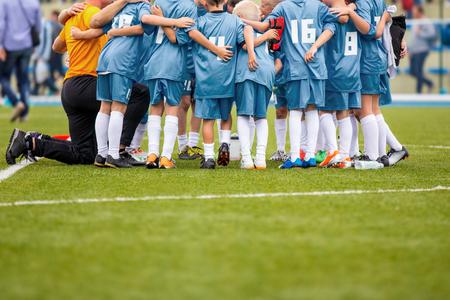 Youth soccer football team gathering Foto de archivo