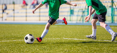 sports training: Football soccer match. Training and game for children. Stock Photo