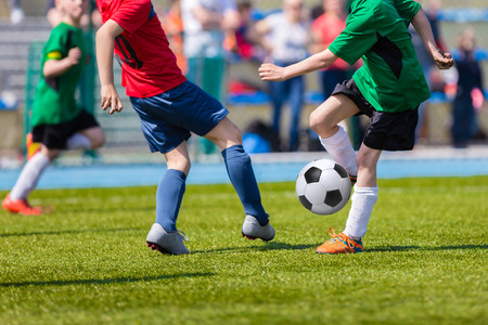 physical education: Football soccer match for children. Kids playing soccer game tournament cup. Physical education classes at school.