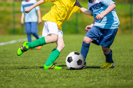 Football soccer match for children. kids playing soccer game tournament. physical education classes at school. Stock Photo