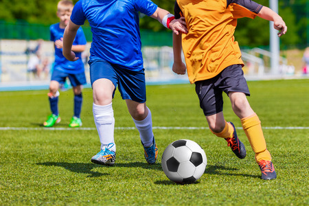 football teams: Children Playing Soccer Football Match. Sport Soccer Tournament for Youth Teams.