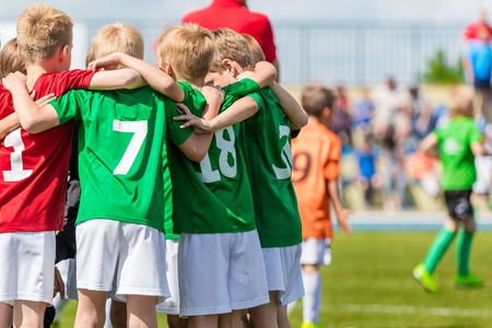 sports club: Kids on soccer field. Youth football team united, shout team before the final game. Team work sports background