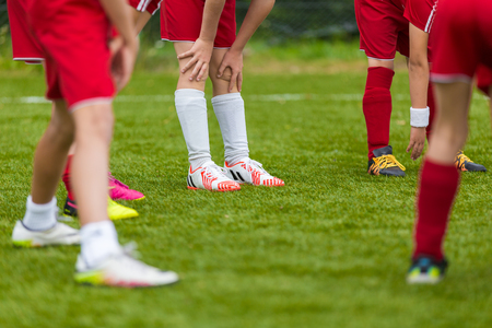 warm up: Soccer Stretching - Flexibility Exercises for Youth Soccer Players. Training Session and Warm Ups Before The Football Match. Stock Photo