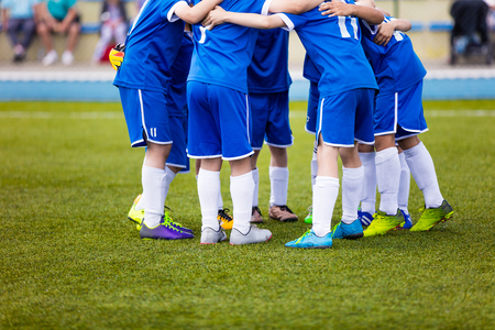 Football match for children. Youth sports team celebrate. Shout team, football soccer game