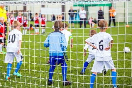 children at play: Children Play Football. Boys Kicking Football Game Stock Photo