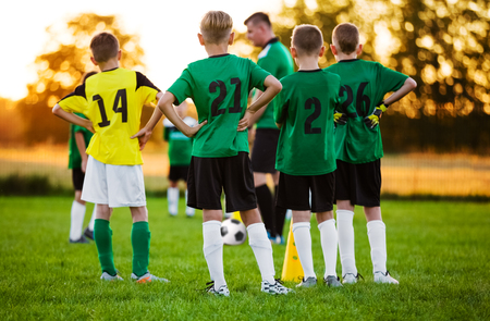 Football Soccer Training for Children. Soccer Team Training on Pitch. Young Boys Standing in a Row. Youth Football Team with Coach on Training Session. Soccer Horizontal Background