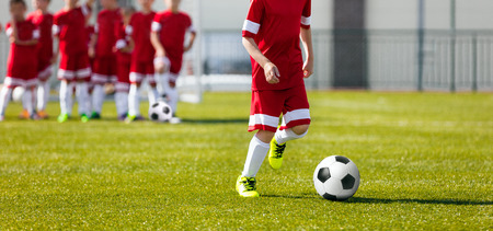 Soccer Football Training for Kids. Youth Soccer Academy Training. Boy Kicking Soccer Ball Stock Photo