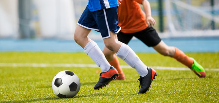 Running Training for Soccer. Soccer Players Running Session. Youth Soccer Players Tackle and Compete on Grass Pitch