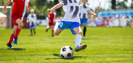 Young Player Kicking Soccer Ball. Stock Photo