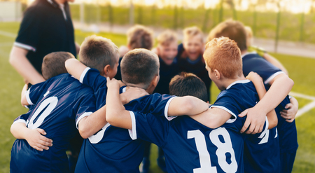 Boys Sport Team Huddle. Kids of Soccer Team Gathered Before the Tournament Final Match. Coach and Young Football Players Huddling. Sports Competition for Children Stok Fotoğraf - 119827299